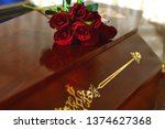 coffin with flowers on the lid. ... | Shutterstock . vector #1374627368