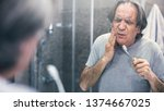 old man with toothache | Shutterstock . vector #1374667025