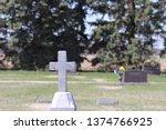 Stone Cross Pillar In Cemetery