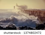 Big Waves Break Against A Pier...