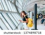 teen girl using smarthphone... | Shutterstock . vector #1374898718