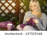 Woman Knitting On Terrace