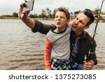 close up of father and son... | Shutterstock . vector #1375273085