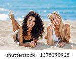 two young women with beautiful... | Shutterstock . vector #1375390925
