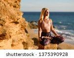 woman enjoying the sunset on a... | Shutterstock . vector #1375390928