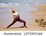 caucasian woman practicing yoga ... | Shutterstock . vector #1375391168