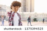 young curly haired woman... | Shutterstock . vector #1375394525