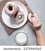 donuts with white icing and... | Shutterstock . vector #1375444562
