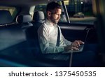 businessman working late in car ... | Shutterstock . vector #1375450535