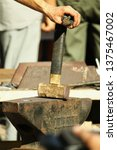 blacksmith's hand with a hammer ...   Shutterstock . vector #1375467002