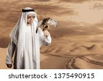 sheik with sunglasses holding a ...   Shutterstock . vector #1375490915