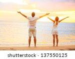 happy cheering couple enjoying... | Shutterstock . vector #137550125
