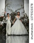 Small photo of NEW YORK, NY - APRIL 11: Designer Madeline Gardner and model walk the runway during the Morilee by Madeline Gardner Spring 2020 fashion show at New York Fashion Week: Bridal on April 11, 2019 in NYC