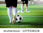 kid soccer player put white... | Shutterstock . vector #1375538228