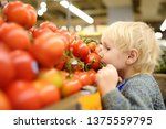 cute toddler boy in a food... | Shutterstock . vector #1375559795