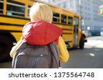 pupil with schoolbag with... | Shutterstock . vector #1375564748