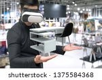 Small photo of Vitual reality marketing technology for access entire product inventory in-store concept. Man suit use VR wearable device application for simulate furniture and colour in retail store. 3D rendering.