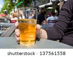 man drinking cider in terrace | Shutterstock . vector #137561558