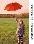 little girl with umbrella... | Shutterstock . vector #137566256