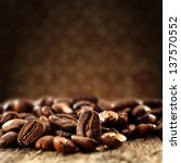 coffee beans and brown wall | Shutterstock . vector #137570552