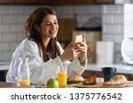 young smiling woman in bathrobe ... | Shutterstock . vector #1375776542