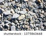 white stones on the seashore   Shutterstock . vector #1375863668