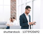 young businessman with... | Shutterstock . vector #1375920692