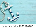 Anchor on a blue vintage wooden ...