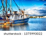 A Weathered Fishing Boat Docke...