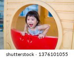 asian baby girl playing on... | Shutterstock . vector #1376101055
