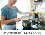 young housewife with hot cooked ... | Shutterstock . vector #1376147708