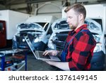 young professional repairman of ... | Shutterstock . vector #1376149145