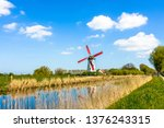 Windmill On The Banks Of The...