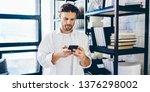 serious caucasian man in casual ... | Shutterstock . vector #1376298002