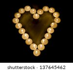 Heart made with candles - stock photo