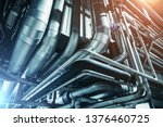 Small photo of Industrial steel pipes or tubes of air ventilation system as abstract industry equipment background in blue tones