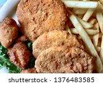 three salmon patties on a plate ...   Shutterstock . vector #1376483585