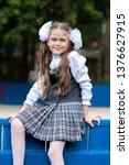 schoolgirl in school uniform... | Shutterstock . vector #1376627915