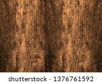 the dark brown wood texture... | Shutterstock . vector #1376761592