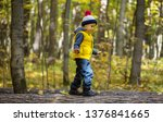 a little boy in a cap walks on...   Shutterstock . vector #1376841665