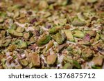 green pistachios on white icing | Shutterstock . vector #1376875712