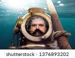 portrait of man in old diving... | Shutterstock . vector #1376893202