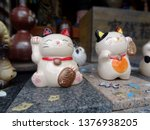 Close Up Picture Of Two Maneki...