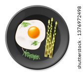 fried eggs with asparagus on...   Shutterstock .eps vector #1376972498