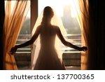 Bride Looking Through The...