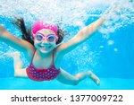 Little Girl Deftly Swim...