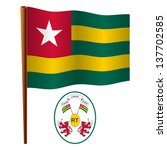 togo wavy flag and coat of arm... | Shutterstock .eps vector #137702585
