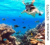 beautiful woman snorkeling in...   Shutterstock . vector #137707772