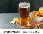 glass of lager beer with snack...   Shutterstock . vector #1377119552