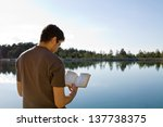 Young Man In Front Of Lake...